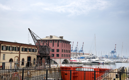 architecture monumental: Dockside Buildings on the quayside in the Port of Genoa Italy Editorial