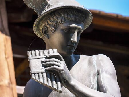 gods: Statue of Hermes or Mercury the hmessenger of the gods  in the City Walls of Krakow in Poland