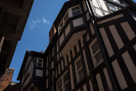 The Rows are Tudor Black and White Buildings in Chester the county city of Cheshire in England. Much of the architecture of central Chester looks medieval and some of it is but by far the greatest part of it, including most of the black-and-white building