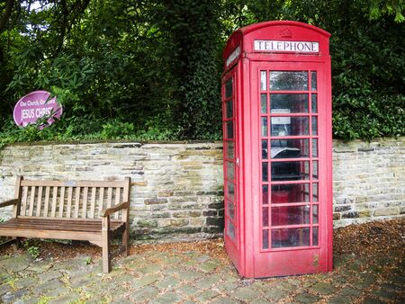 Red Telephone Box in the small village of Pott Shrigley, Cheshire, England. Editorial