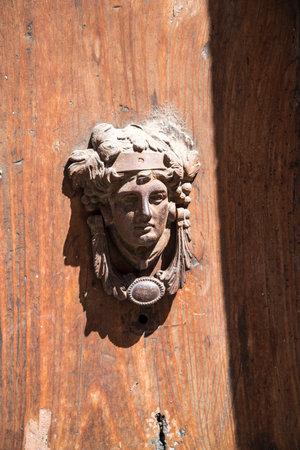 devotional: Door Knocker in Rome Italy