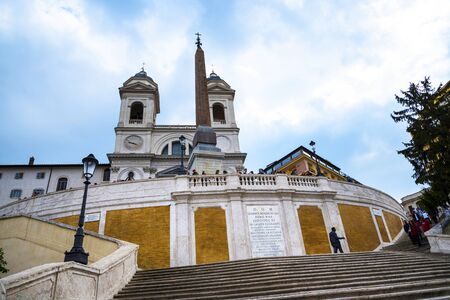 The church of Trinite dei Monti at the top of the Spanish Steps with its Egyptian obelisk in Rome Italy