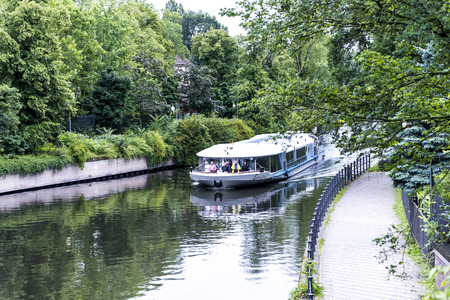 River Through Zoological Gardens and Aquarium in Berlin Germany. The Berlin Zoo is the most visited zoo in Europe, with more than 3.3 million visitors per year from all over the world.