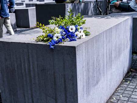 """The Holocaust memorial by the Brandenburg Gate in Berlin Germany The monument is located on the former location of the Berlin Wall, where the """"death strip"""" once divided the city. The monument is composed of 2711 rectangular concrete blocks, laid out i Editorial"""