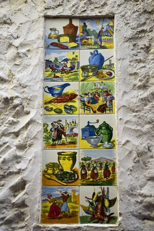 Old Tiles on Wall of Building in the old Town of Marbella Spain depicting aspects of Spanish Life