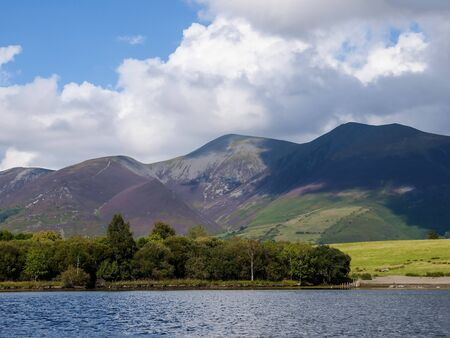Derwentwater is one Keswicks main assets. Derwentwater is only a short stroll from the town centre via Hope Park with its beautiful formal gardens. The lake is three miles long and is fed by the River Derwent catchment area in the high fells at the head of Borrowdale. Stock Photo