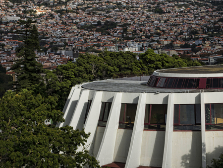 Funchal is the Capital of the island of Madeira. The distinctive houses and roofs seem to pile on top of each other as the land rises steeply from the Atlantic Ocean. It is a bustling and thriving city by the sea. Editorial