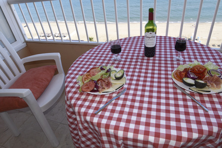 Lunch on Apartment Balcony overlooking the beach and the sea in Fuengirola on the Costa del Sol in Spain Editorial