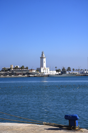 port lighthouse in Malaga is the Capital  city of the province of Andalucia in Southern Spain Editorial