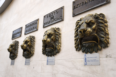 Post Boxes with Lions heads on the main post Office in Fuengirola on the Costa del Sol in Spain
