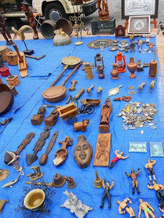 Flea market items on the Market at the Feria Ground in Fuengirola on the Costa del Sol Spain Foto de archivo - 104406094