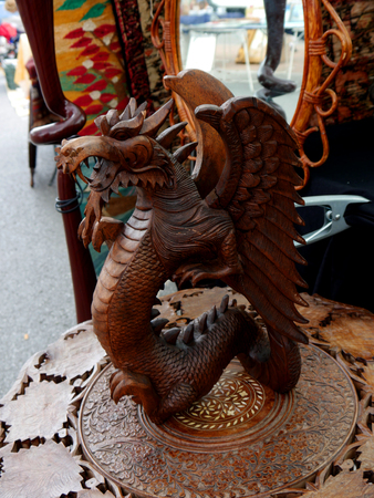 Large carved wood Oriental Dragon for sale on the Sunday Flea Market in Fuengirola on the Costa del Sol in Southern Spain Stock Photo