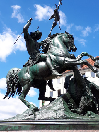 Statue of St George killing the Dragon in the Nikolaikirche area of Berlin Germany Banque d'images - 110649859