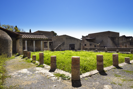 Herculaneum, or Ercolano, near Naples in Italy was not buried by falling rocks like Pompeii was in the eruption of Vesuvius in 79AD, instead it was engulfed in boiling mud and superheated air. This preserved roofs, buildings and artefacts Banco de Imagens - 110649867