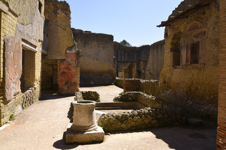Villa in Herculaneum, or Ercolana, near Naples in Italy was not buried by falling rocks like Pompeii was in the eruption of Vesuvius in 79AD, instead it was engulfed in boiling mud and superheated air. This preserved roofs, buildings and artefacts Banco de Imagens - 110649868