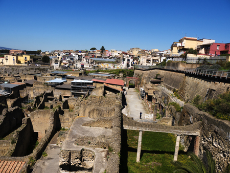 The city of Herculaneum, or Ercolana, near Naples in Italy was not buried by falling rocks like Pompeii was in the eruption of Vesuvius in 79AD, instead it was engulfed in boiling mud and superheated air. This preserved roofs, buildings and artefacts Editorial