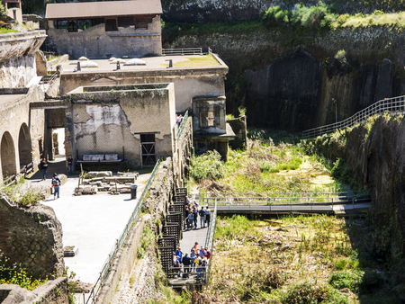 The sea front warehouses in Herculaneum, or Ercolana, near Naples in Italy was not buried by falling rocks like Pompeii was in the eruption of Vesuvius in 79AD, instead it was engulfed in boiling mud and superheated air. This preserved roofs, buildings an Banco de Imagens - 110649888