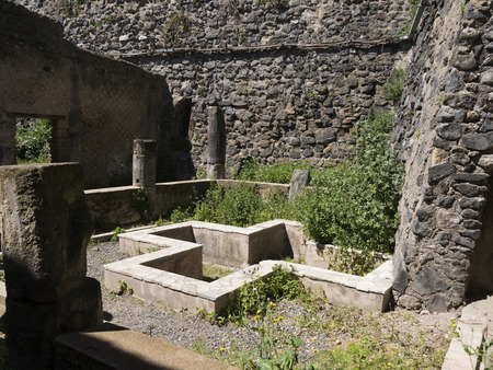 Garden water feature in Herculaneum, or Ercolana, near Naples in Italy was not buried by falling rocks like Pompeii was in the eruption of Vesuvius in 79AD, instead it was engulfed in boiling mud and superheated air. This preserved roofs, buildings and ar 報道画像