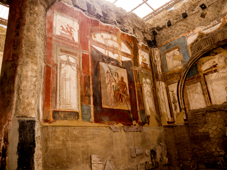 the Temple of Augustus in Herculaneum, or Ercolana, near Naples in Italy was not buried by falling rocks like Pompeii was in the eruption of Vesuvius in 79AD, instead it was engulfed in boiling mud and superheated air. This preserved roofs, buildings and  Banco de Imagens - 110649895