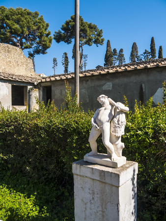 statue in garden of villa in Herculaneum, or Ercolana, near Naples in Italy was not buried by falling rocks like Pompeii was in the eruption of Vesuvius in 79AD, instead it was engulfed in boiling mud and superheated air. Banco de Imagens - 110649910