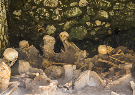 Bodies huddled in Warehouse on beach in Herculaneum, or Ercolana, near Naples in Italy was not buried by falling rocks like Pompeii was in the eruption of Vesuvius in 79AD, instead it was engulfed in boiling mud and superheated air.