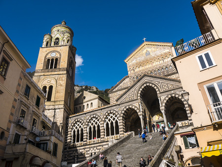 Amalfi, Campania, Italy 05 April 2018 The Glittering Saint Andrew's Cathedral in Amalfi. The cathedral dates back to the 11th century. The stairs were built in 1203. It gleams in the Italian Sunshine
