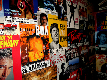 Old pop concert posters of bands who played in Berlin  20 years ago in the restrooms in cafe in the Nikolaikirche area Editorial