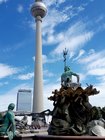 Berlin Germany the  Neptune Fountain and tThe television tower or Fernsehturm. It is possible to go up to the viewing platform for vistas over the city