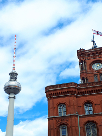 Berlin Germany The Red Brick Town Hall and the television tower or Fernsehturm. It is possible to go up to the viewing platform for vistas over the city Editorial