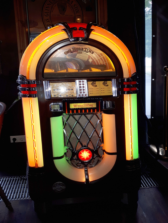 Jukebox in one of the many Irish Bars filled with Bygone Ephemera in Berlin Germany Editorial