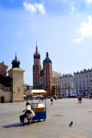 The Market Square, the Mariacki Church and the Cloth Hall in Krakow Poland Editorial