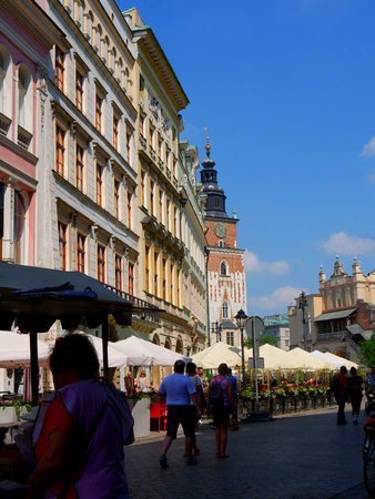 The Market Square is lined with cafes in Krakow Poland