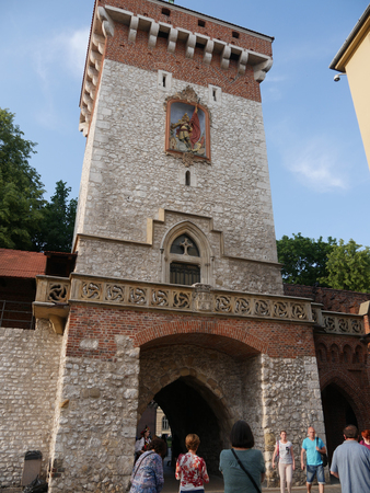 The medieval St Florians Gate with the Barbican along the Royal Coronation Route. It is a historic gateway leading into the Old Town of Krakow, Poland
