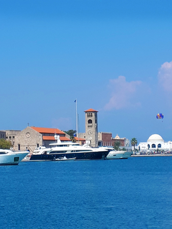 Mandraki Harbour with The Governors Palace and Church of the Assumption modelled on the Doges Palace in Venice Italy
