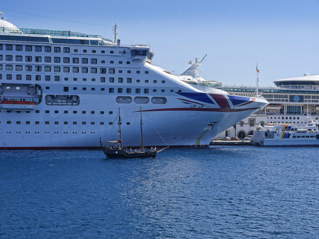 Cruise ship docked in the deep water harbour on the island of Rhodes Standard-Bild - 117154211