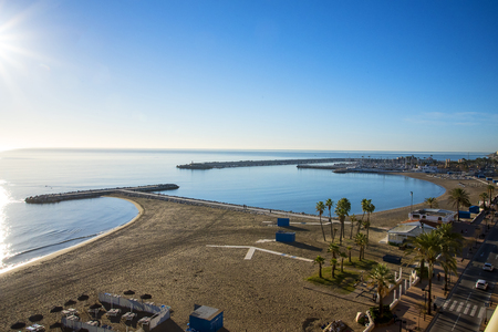 The beach and breakwater at Fuengirola on the Costa del Sol in Spain Stock Photo - 118750945