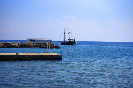 Sailing into the entrance to Mandraki Harbour on the island of Rhodes Stock Photo