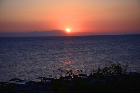 Sunset over Ellie Beach which is the nearest beach to Rhodes Town on the island of Rhodes Stock Photo