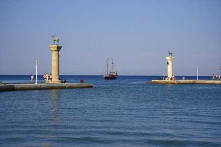 the statues at the entrance to Mandraki Harbour on the island of Rhodes