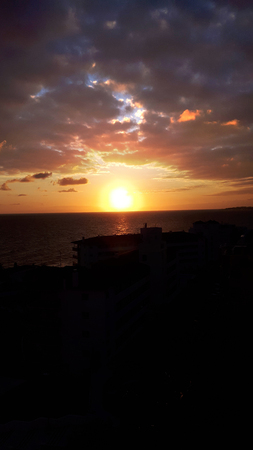 Sunset over the sea from hotel balcony in Nerja Andalucia Spain