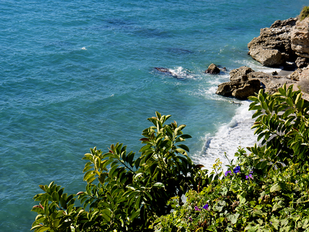 Coastline and cliffs at Nerja in Southern Spain. The resort has seven beaches and a very mild climate