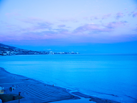 Evening falls over the beach in Fuengirola on the Costa del Sol Spain