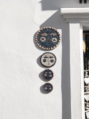 Plaques by doorway in Mijas one of the white villages in Andalucia Spain