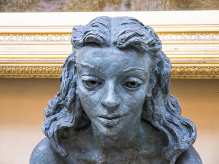 Bronze head of a girl  on display in an English museum