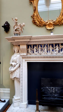 Marble fireplace with figure of woman holding a basket
