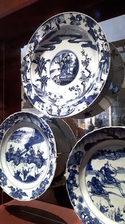 Chinese plates on display in museum Editorial