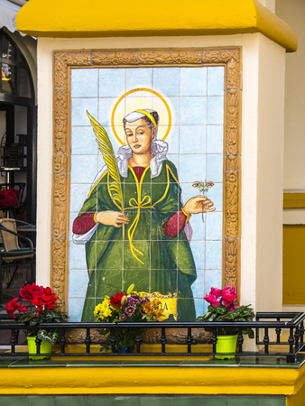 Image of St Lucy on the street in Fuengirola Spain. She carries eyes on a stalk and is the patron saint of the blind Stock Photo - 120450820