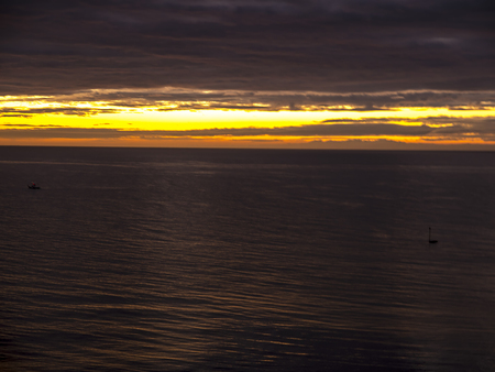 Startling sunset over the sea in Fuengirola on the Costa del Sol Spain Фото со стока