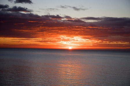 Dramatic Sunset over the sea in Fuengirola on the Costa del Sol Stock Photo - 121393829