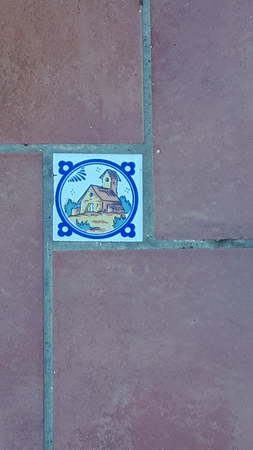 Pictorial floor tile on terrace in the street in Mijas above the Costa del Sol in Spain